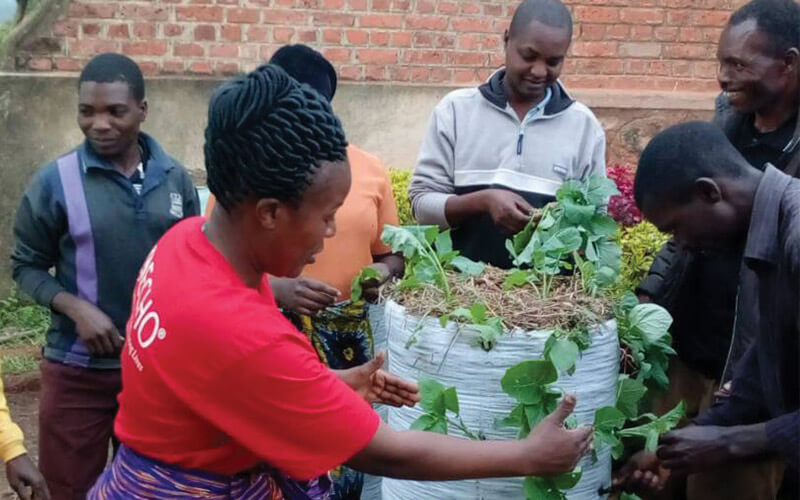 East Africa Staff teaches how to make sack gardens